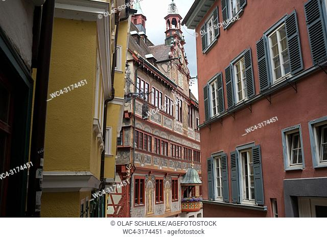 06. 06. 2017, Tuebingen, Baden-Wuerttemberg, Germany, Europe - A narrow alleyway with historic buildings in Tuebingen's old town with the town hall in the...