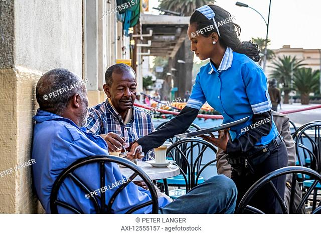 Eritrean men having coffee at the Impero café; Asmara, Central Region, Eritrea
