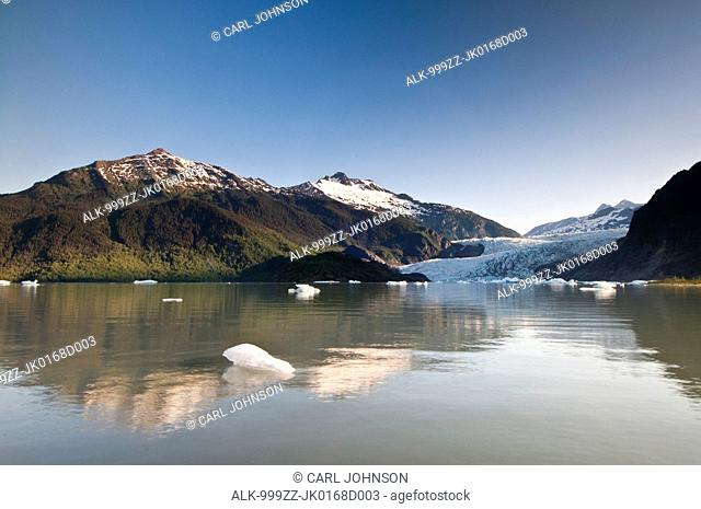 Scenic view of icebergs floating in Mendenhall Lake with Mendenhall Glacier in the background, Tongass National Forest near Juneau, Southeast Alaska, Summer