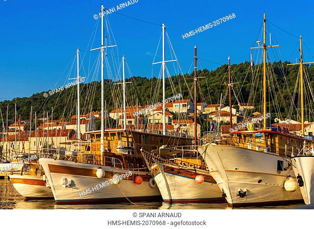 Croatia, Dalmatia, Dalmatian coast, Korcula Island, Korcula, pleasure yachts moored at the dock of a marina at sunrise