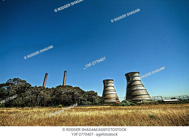 Chimneys and cooling towers at an old power station near Cape Town, South Africa