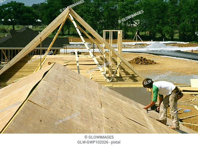 Carpenter putting roof for new home