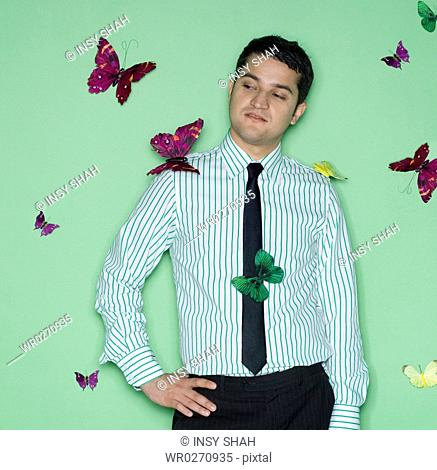 Young man with a butterflies