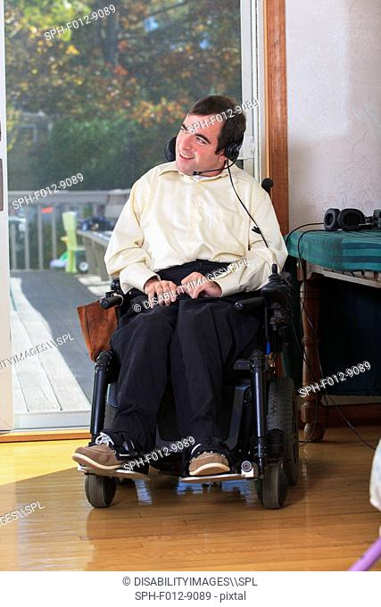 Man with Cerebral Palsy in motorized wheelchair using a hands free headset