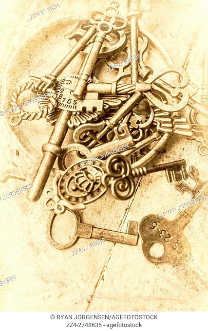 Vintage grainy / noisy object photo on skeleton keys laying in a unlocked jar lid. Vintage openings