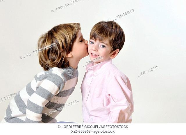 girl kisses a boy