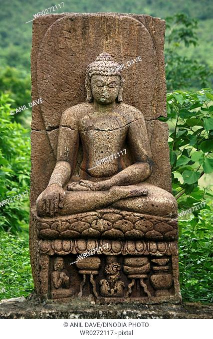 Ruined statue of Buddha in heritage Buddha excavated site , Ratnagiri , Orissa , India