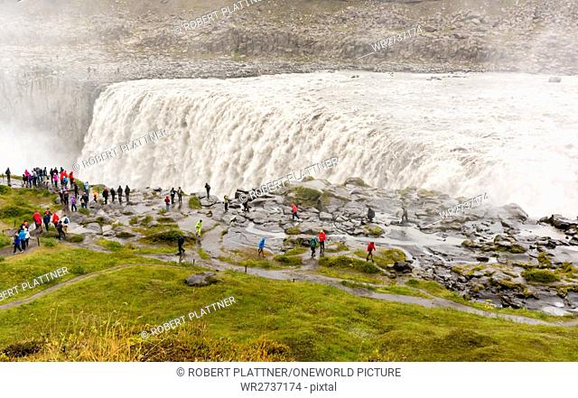 Iceland, Norðurland eystra, people in front of the Dettifoss waterfall on the river Jökulsá á Fjöllum, northeast Iceland