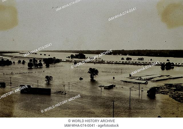Photograph of The Great Mississippi River flood, at the Tent camp of refugees on river levee. Dated 1927