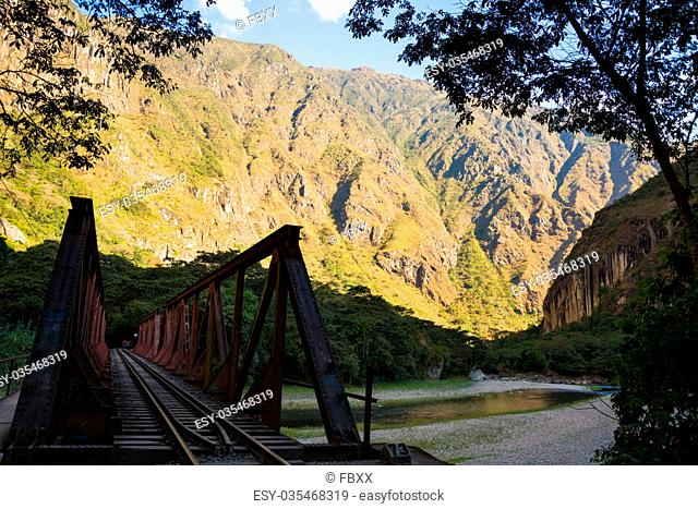 Iron bridge on the railroad track crossing jungle and Urubamba river, connecting Machu Picchu village to hydroelectric station