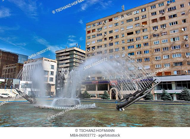 Romania, small Walachei, city of Drobeta Turnu Severin, fountain in front of a building in the city centre