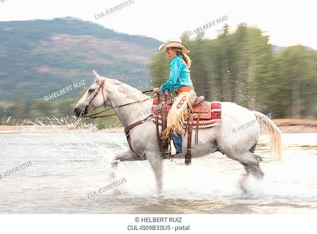 Mature woman riding horse, Missoula, Montana, USA