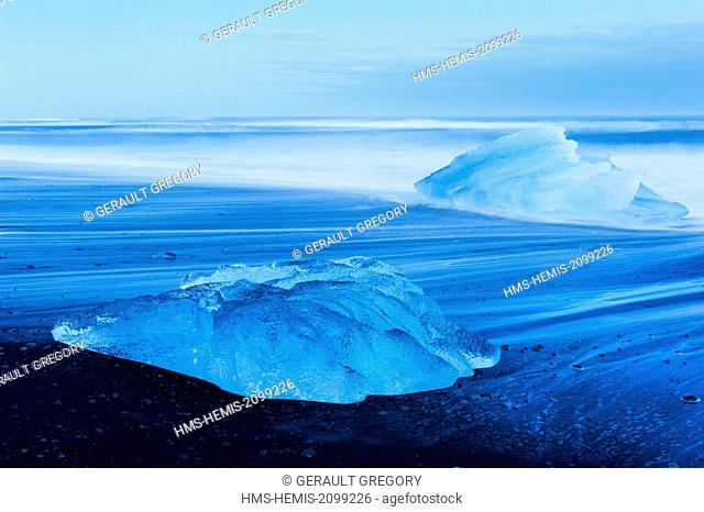 Iceland, Austurland, Jokulsarlon, beached iceberg on a black sand beach