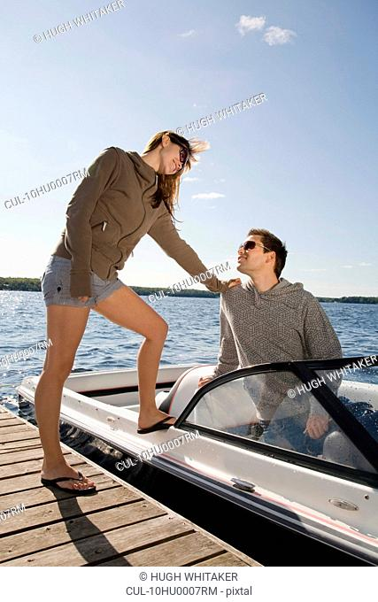 Couple with speedboat next to dock