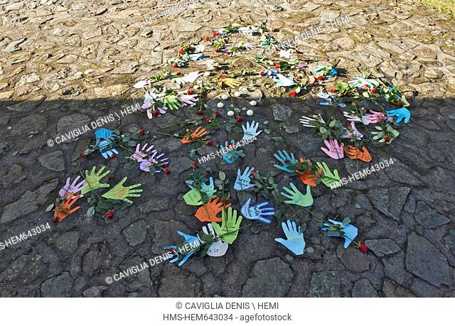 France, Bas Rhin, Natzwiller, Struthof KL Natzwiller Camp and the European Centre of Deported Resistance Members, Paper hands and flowers in memory of the...