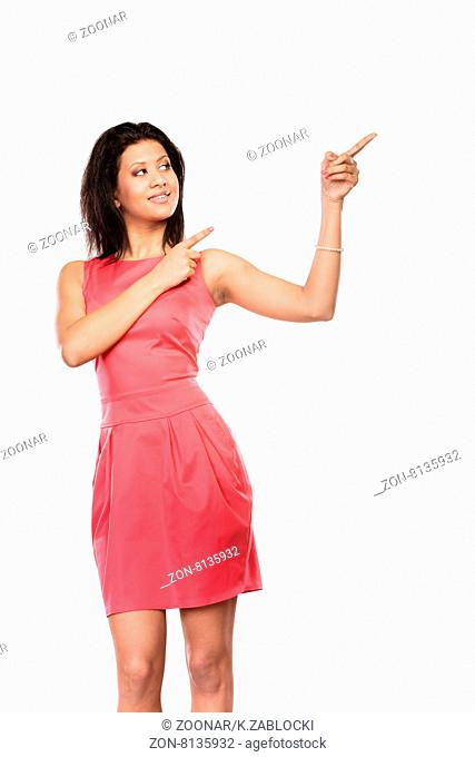 Pretty woman pointing at empty blank copy space