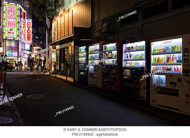 Entertainment area alley with restaurant and vending machines at night in Shibuya, Tokyo, Japan