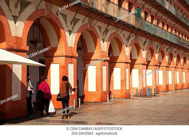 People in front the arches in Plaza de la Corredera Square, Cordoba, Andalucia, Spain, Europe
