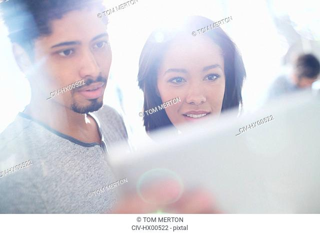 Close up business people using digital tablet