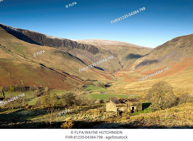 View of derelict barn and farmland in fell valley with waterfall in distance, Cautley Crag and Yarlside with Cautley Spout inbetween, Sedbergh, Howgill Fells