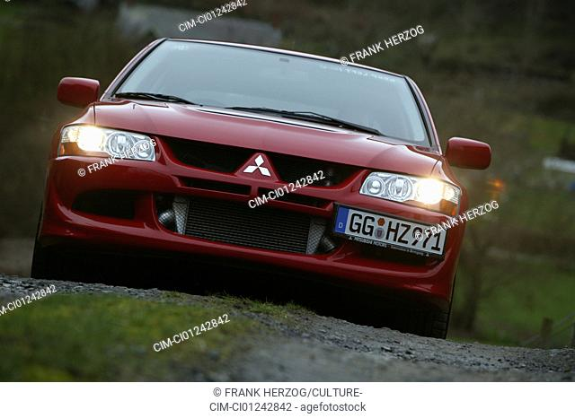 Car, Mitsubishi Lancer Evolution VIII, Limousine, model year 2004-, ruby colored, roadster, standing, upholding, diagonal from the front, frontal view, offroad