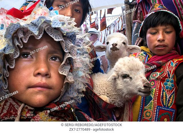 Sacred Valley, Pisac, Peru. Children dressed in traditional costume in Pisac Sunday market day. Pisac. Sacred Valley. Pisac, or Pisaq in Quechua