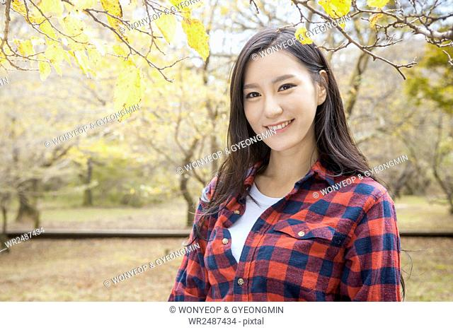 Portrait of young smiling woman in forest