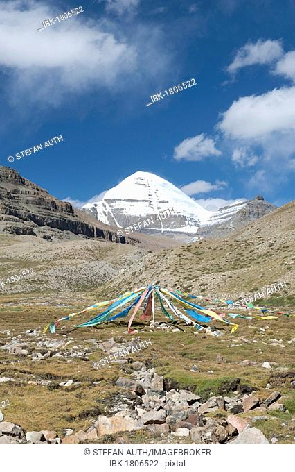 Tibetan Buddhism, colorful prayer flags, snow-covered holy Mount Kailash, Gang Rinpoche mountain, south face with cleft, pilgrims' path near Selung Gompa...