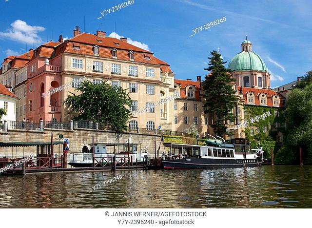 Historic buildings on the Vltava river in Prague, Czech Republic