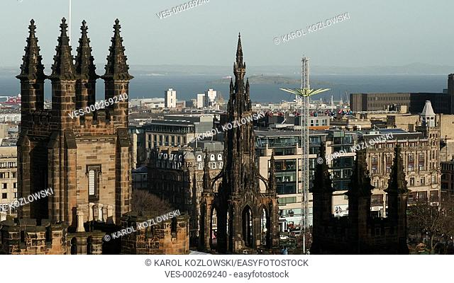 Edinburgh Cityscape with the Scott Monument and Amusement Park on Christmas Market in Scotland, United Kingdom