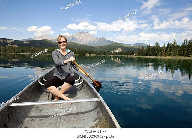 Caucasian woman paddling in kayak