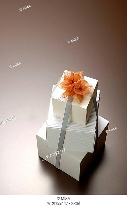 Three gift boxes with ribbon