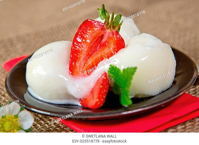 Ice cream with strawberry isolated on brown cloth background