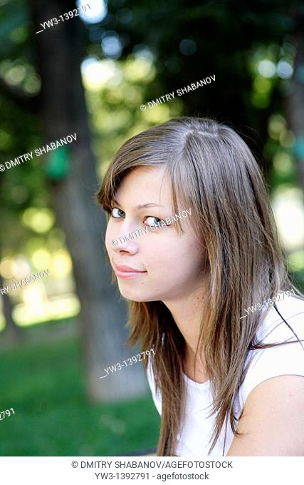 Beautiful woman with in the summer park
