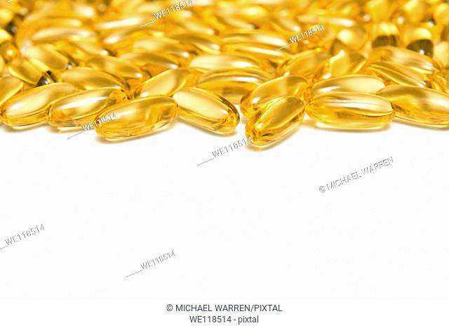 Beautiful Golden Fish Oils Capsules on a White Background