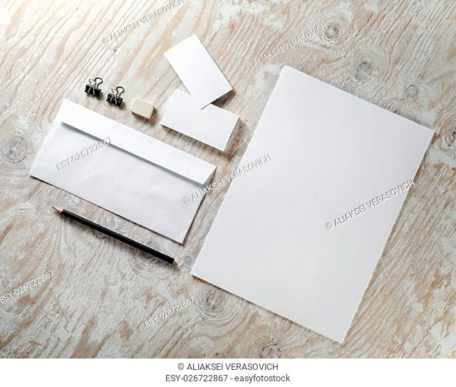 Blank stationery set on light wooden background. Mock-up for ID. Template for design presentations and portfolios. Top view