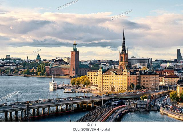 Bridges, railway tracks, church tower, cityscape and water canal, Stockholm, Sweden