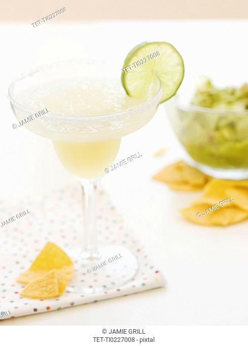 Lime margarita, tortilla chips and guacamole