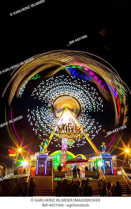 High Energy, carnival ride in motion, night scene, Oktoberfest, Munich, Bavaria, Germany