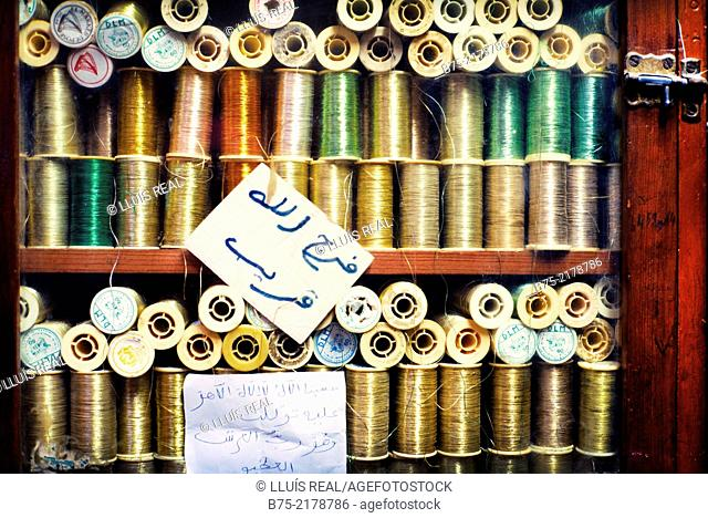 Embroidery threads metallics and different colors in a haberdashery in the Medina of Fez, Morocco, Africa