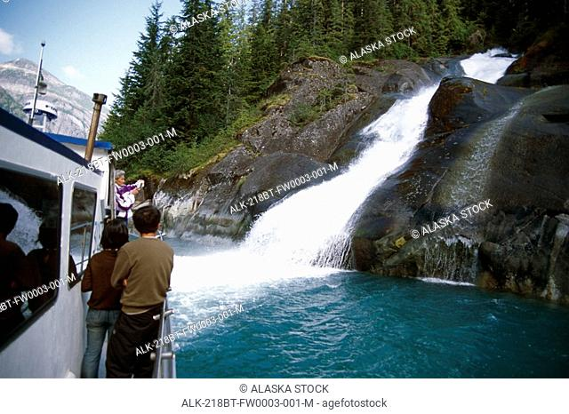 Visitors View Waterfall From Tourboat in Tracy Arm, Fords-Terror Wilderness Area, SE Alaska Summer
