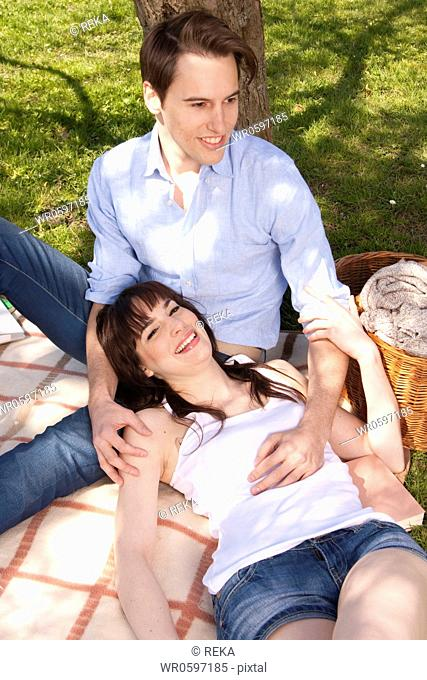 Happy young couple in meadow