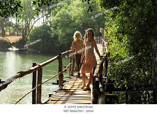 Children on a footbridge Goa India