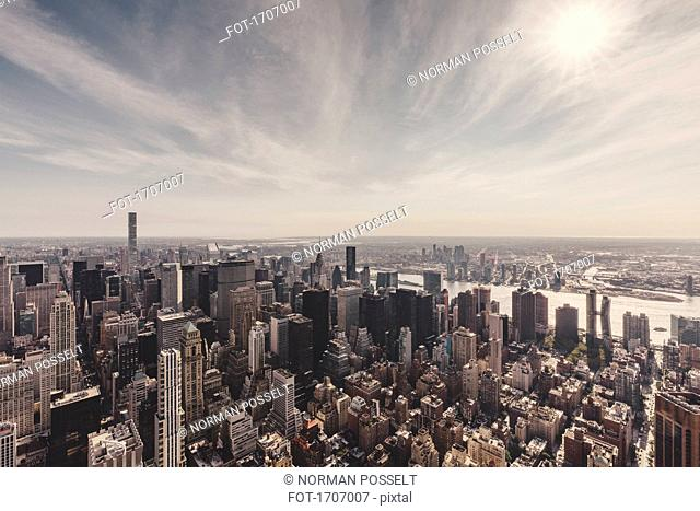 Manhattan and East River against sky seen from Empire State Building, New York City, New York, USA