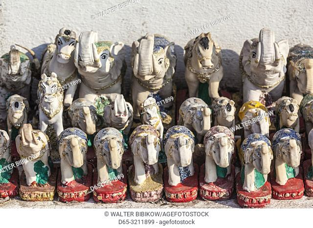Laos, Vientiane, Mekong Riverfront shrine with elephnat miniatures