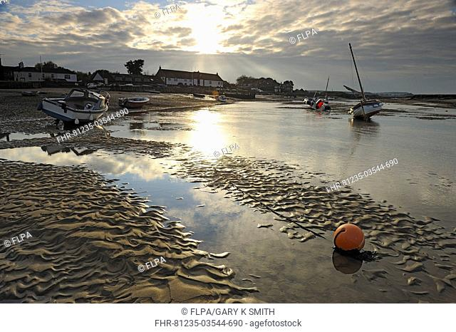 View of boats in harbour at low tide, Burnham Overy Staithe, North Norfolk, England, november