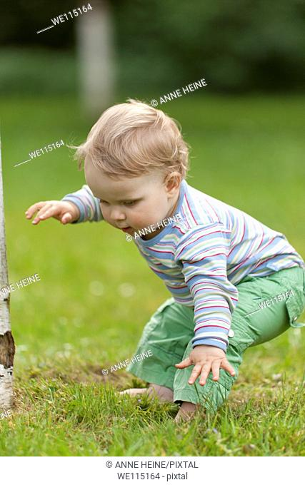 child learning to walk loosing balance outdoors