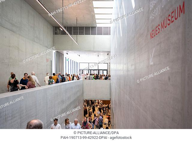 13 July 2019, Berlin: Visitors walk through the James Simon Gallery after the opening. The stairs lead down to the Neues Museum