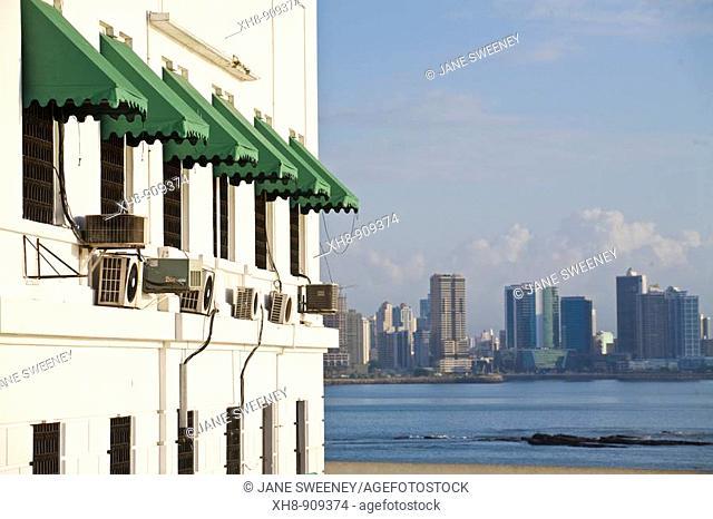 Building on Las Bovedas Promenade and city skyline, Casco Viejo, Panama City, Panama