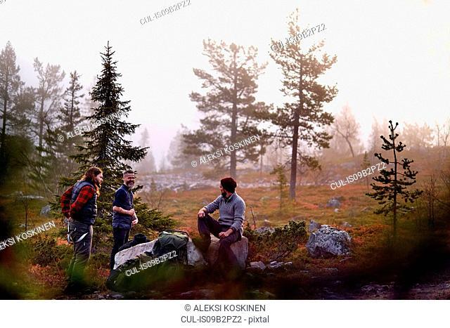 Hikers relaxing in park, Sarkitunturi, Lapland, Finland